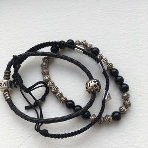Black bracelets set including Pandora